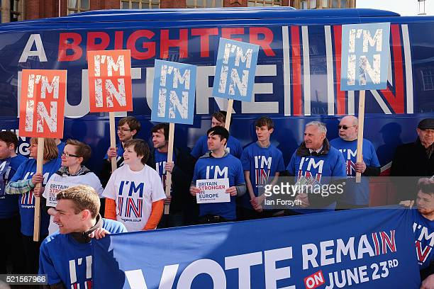 Britain Stronger In Europe supporters hold placards in front of the campaign bus as it arrives at Northumbria University's City Campus on April 16...