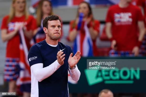 Britain team's captain Leon Smith cheers on his teammates during the Davis Cup world group quarterfinal tennis match between France and Britain on...