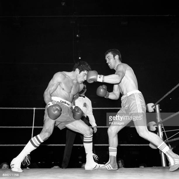 Britain's Alan Minter right lands a left to the head of Gratien Tonna of France