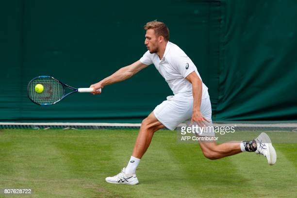 Britain's Alexander Ward returns against Britain's Kyle Edmund during their men's singles first round match on the second day of the 2017 Wimbledon...