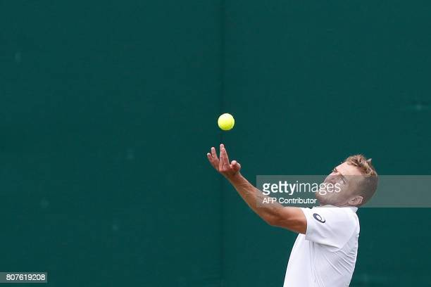 Britain's Alexander Ward serves against Britain's Kyle Edmund during their men's singles first round match on the second day of the 2017 Wimbledon...