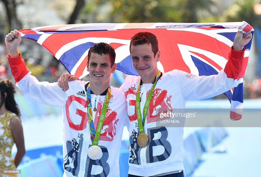 Britain's Alistair Brownlee and Britain's Jonathan Brownlee pose with their medals after the men's triathlon at Fort Copacabana during the Rio 2016...