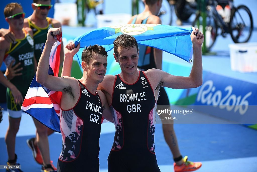Britain's Alistair Brownlee and his brother Britain's Jonathan Brownlee celebrate after winning the men's triathlon at Fort Copacabana during the Rio...