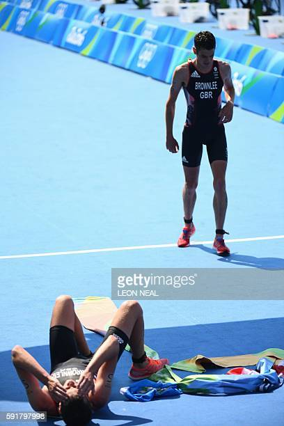 Britain's Alistair Brownlee and his brother Britain's Jonathan Brownlee celebrate reach the finish line in the men's triathlon at Fort Copacabana...