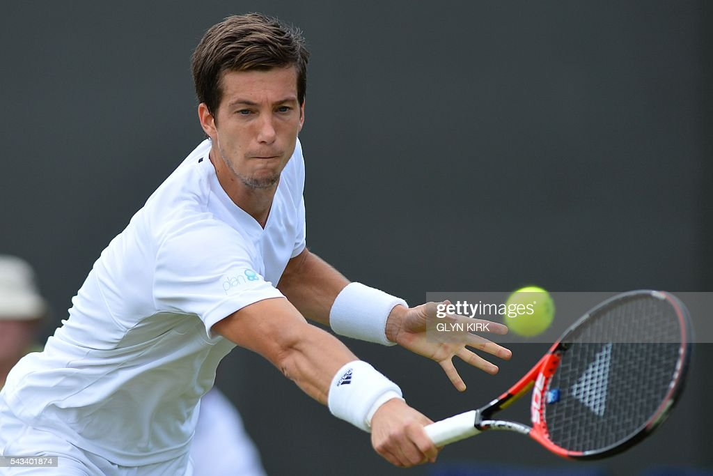 Britain's Aljaz Bedene returns against France's Richard Gasquet during their men's singles first round match on the second day of the 2016 Wimbledon Championships at The All England Lawn Tennis Club in Wimbledon, southwest London, on June 28, 2016. / AFP / GLYN