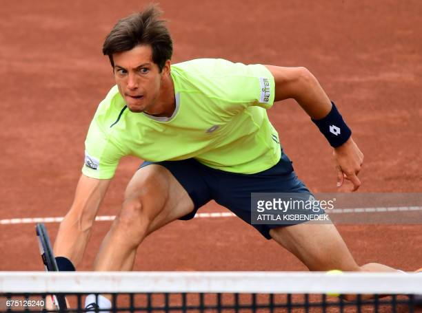 Britain's Aljaz Bedene returns the ball to France's Lucas Pouille during their final tennis match at the Hungarian Open in Budapest on April 30 2017...