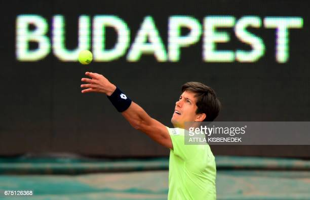 Britain's Aljaz Bedene serves the ball to France's Lucas Pouille during their final tennis match at the Hungarian Open in Budapest on April 30 2017 /...