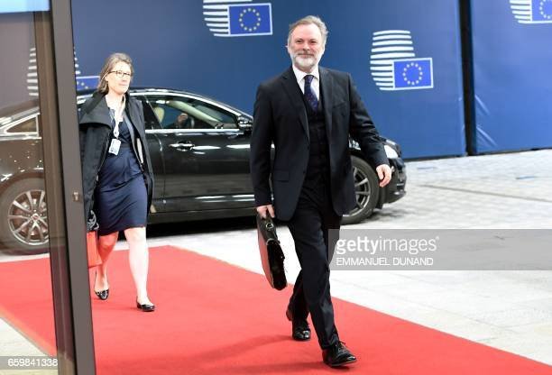 Britain's ambassador to the EU Tim Barrow arrives at the European Council in Brussels on March 29 2017 Tim Barrow will deliver to European Council...