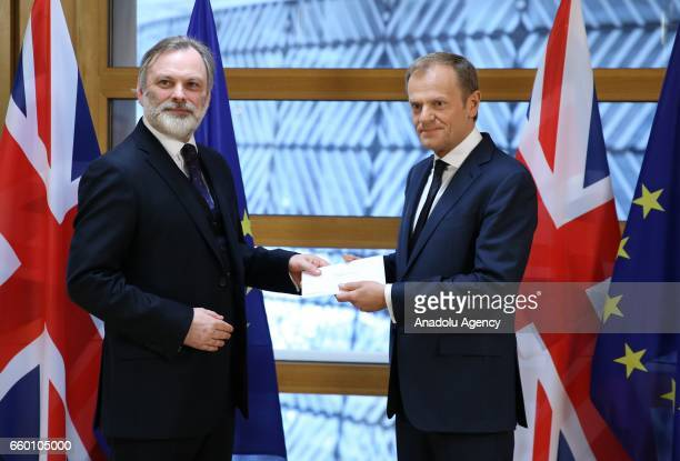 Britain's ambassador to the EU Tim Barrow delivers British Prime Minister Theresa May's formal notice of the UK's intention to leave the bloc under...