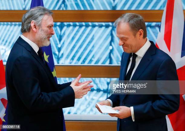 Britain's ambassador to the EU Tim Barrow gestures as he delivers British Prime Minister Theresa May's formal notice of the UK's intention to leave...