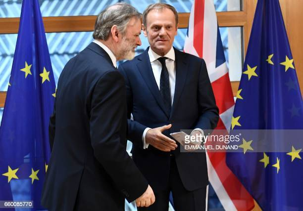 Britain's ambassador to the EU Tim Barrow leaves after delivering British Prime Minister Theresa May's formal notice of the UK's intention to leave...