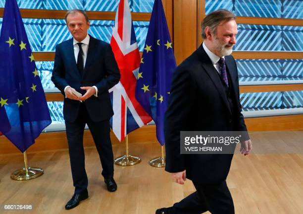 Britain's Ambassador to the EU Tim Barrow walks away after handing European Council President Donald Tusk the British prime minister's formal notice...
