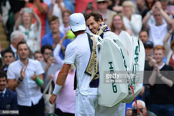 Britain's Andy Murray and Britain's Liam Broady leave the court together after Murray won their men's singles first round match on the second day of...