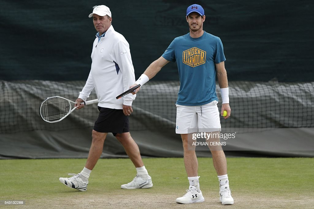 Britain's Andy Murray (R) and Czech-US coach Ivan Lendl (L) take part in a practice session at The All England Tennis Club in Wimbledon, southwest London, on June 26, 2016, on the eve of the start of the 2016 Wimbledon Championships tennis tournament. / AFP / ADRIAN