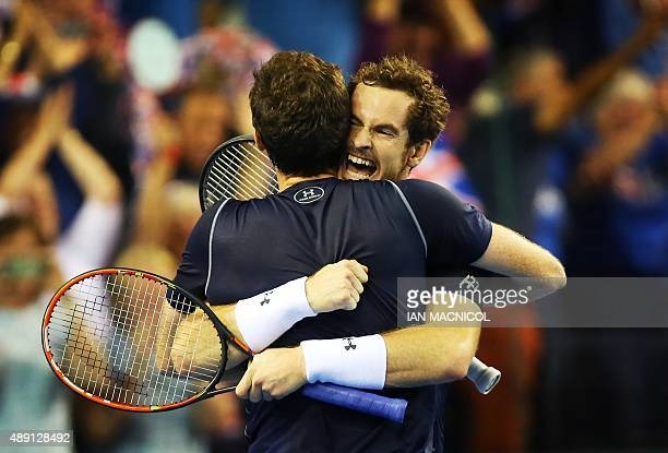 Britain's Andy Murray and Jamie Murray celebrate victory in the Davis Cup Doubles match between against Lleyton Hewitt and Sam Groth of Australia in...