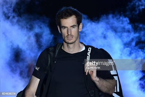 TOPSHOT Britain's Andy Murray arrives on court to play against Serbia's Novak Djokovic during the men's singles final on the eighth and final day of...