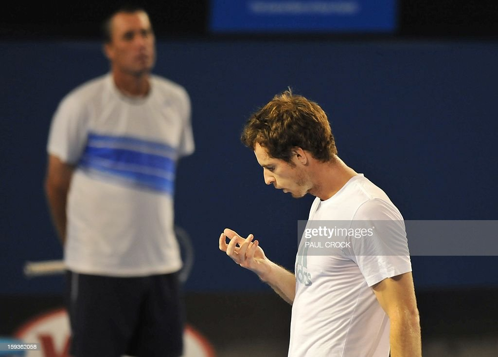 Britain's Andy Murray (R) attends a training session as his coach Ivan Lendl watches on ahead of the Australian Open tennis tournament in Melbourne on January 13, 2013. AFP PHOTO / PAUL CROCK IMAGE STRICTLY RESTRICTED TO EDITORIAL USE - STRICTLY NO COMMERCIAL USE