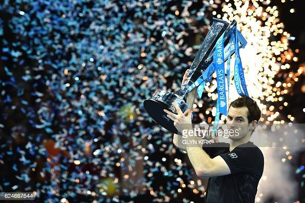 Britain's Andy Murray celebrate with the trophy after winning the men's singles final against Serbia's Novak Djokovic on the eighth and final day of...