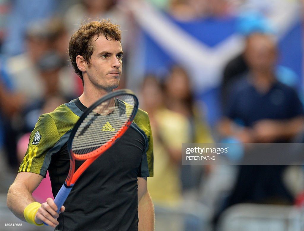 Britain's Andy Murray celebrates after victory in his men's singles match against France's Gilles Simon on the eighth day of the Australian Open tennis tournament in Melbourne on January 21, 2013.