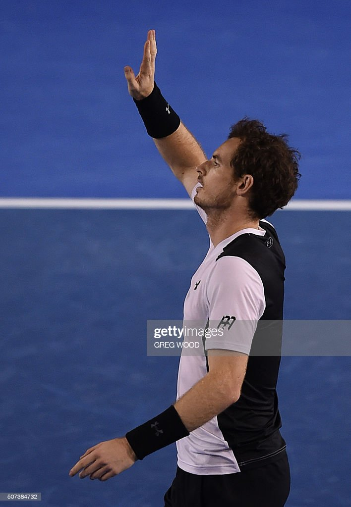 Britain's Andy Murray celebrates after victory in his men's singles semi-final match against Canada's Milos Raonic on day twelve of the 2016 Australian Open tennis tournament in Melbourne on January 29, 2016. AFP PHOTO / GREG WOOD-- IMAGE RESTRICTED TO EDITORIAL USE - STRICTLY NO COMMERCIAL USE / AFP / GREG WOOD