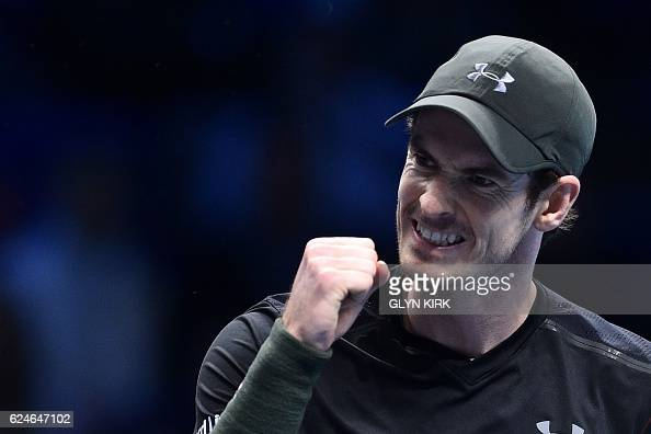 TOPSHOT Britain's Andy Murray celebrates after winning a game in the second set against Serbia's Novak Djokovic during the men's singles final on the...