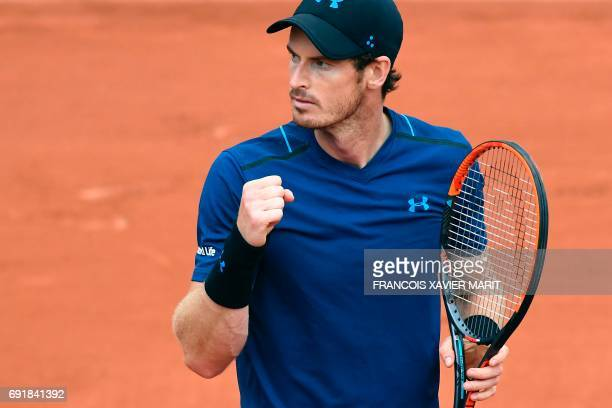Britain's Andy Murray celebrates after winning a point against Argentina's Juan Martin Del Potro during their tennis match at the Roland Garros 2017...