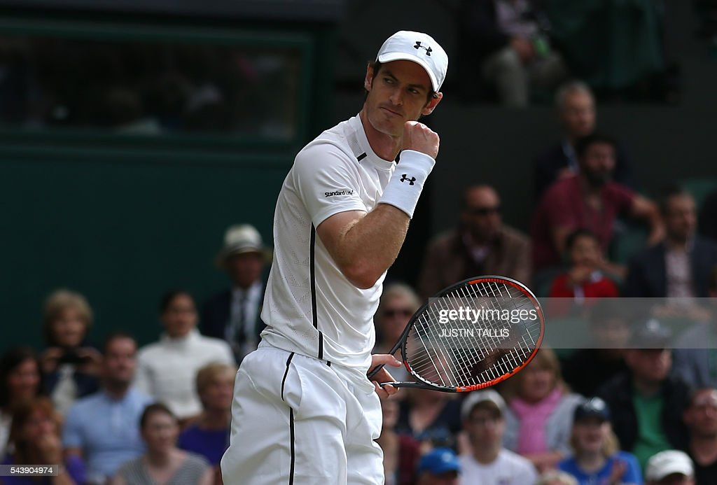 Britain's Andy Murray celebrates after winning the first set against Taiwan's Lu Yen-hsun during their men's singles second round match on the fourth day of the 2016 Wimbledon Championships at The All England Lawn Tennis Club in Wimbledon, southwest London, on June 30, 2016. / AFP / JUSTIN