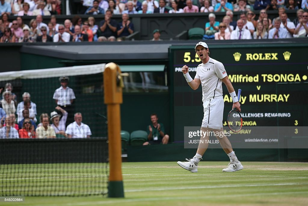 Britain's Andy Murray celebrates winning a point in the first set tiebreaker against France's JoWilfried Tsonga during their men's singles...