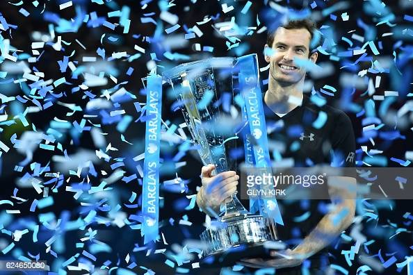 TOPSHOT Britain's Andy Murray celebrates with the trophy after winning the men's singles final on the eighth and final day of the ATP World Tour...