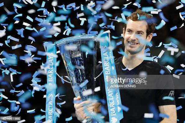 Britain's Andy Murray celebrates with the trophy after winning the men's singles final on the eighth and final day of the ATP World Tour Finals...