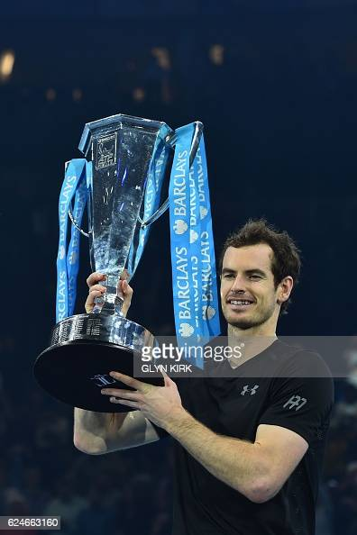 Britain's Andy Murray celebrates with the trophy after winning the men's singles final against Serbia's Novak Djokovic on the eighth and final day of...