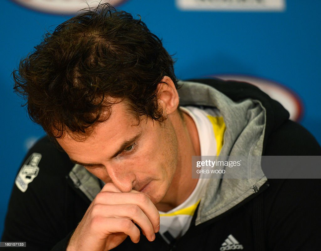 Britain's Andy Murray gestures as he addresses a press conference after defeat in his men's singles final against Serbia's Novak Djokovic on day fourteen of the Australian Open tennis tournament in Melbourne on January 27, 2013. AFP PHOTO/GREG WOOD IMAGE STRICTLY RESTRICTED TO EDITORIAL USE - STRICTLY NO COMMERCIAL USE