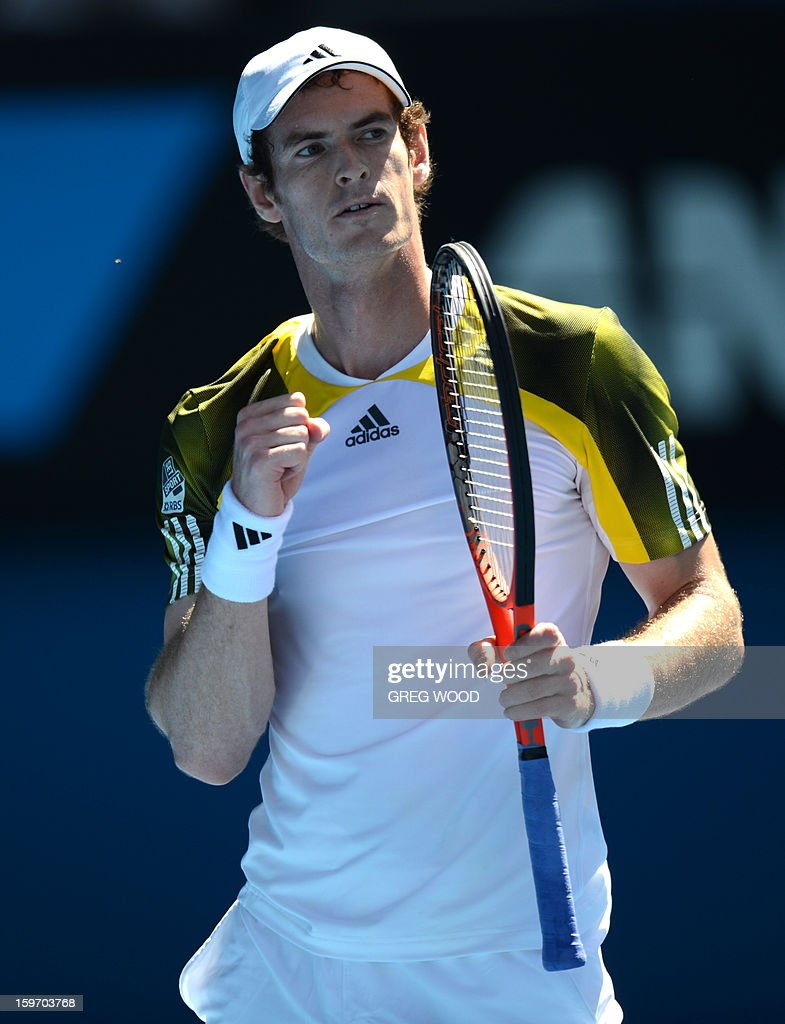 Britain's Andy Murray gestures during his men's singles match against Ricardas Berankis of Lithuania on the sixth day of the Australian Open tennis tournament in Melbourne on January 19, 2013. AFP PHOTO/GREG WOOD IMAGE STRICTLY RESTRICTED TO EDITORIAL USE - STRICTLY NO COMMERCIAL USE