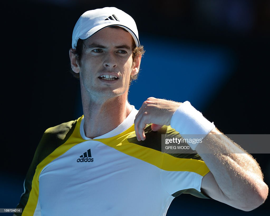 Britain's Andy Murray gestures during his men's singles match against Ricardas Berankis of Lithuania on the sixth day of the Australian Open tennis tournament in Melbourne on January 19, 2013.