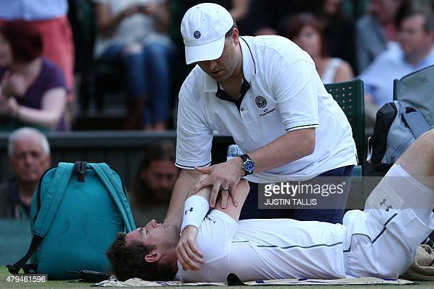 Britain's Andy Murray gets attention to his shoulder during a medical timeout during his men's singles third round match against Italy's Andreas...