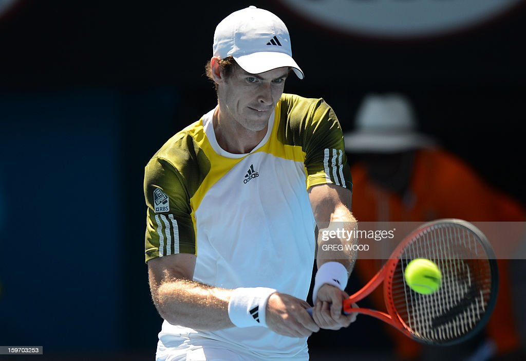 Britain's Andy Murray hits a return against Lithuania's Ricardas Berankis during their men's singles match on day six of the Australian Open tennis tournament in Melbourne on January 19, 2013.