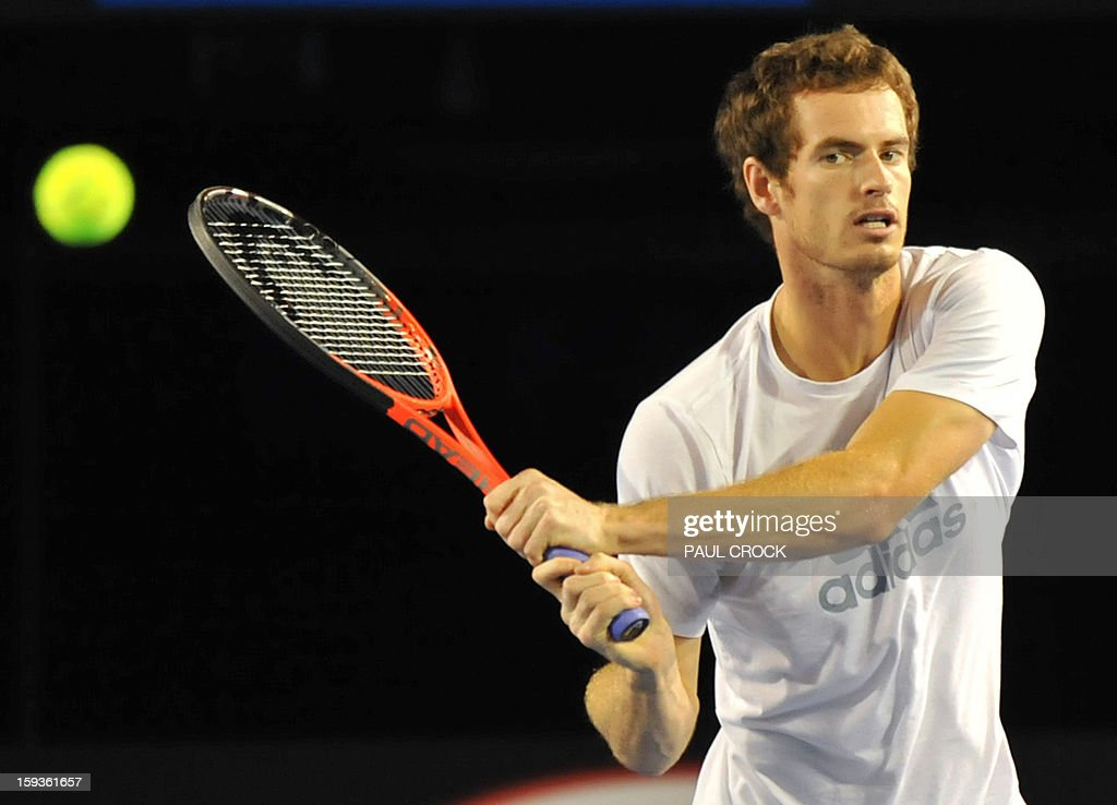 Britain's Andy Murray hits a return during a training session ahead of the Australian Open tennis tournament in Melbourne on January 13, 2013.