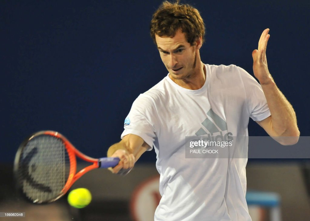 Britain's Andy Murray hits a return during a training session ahead of the Australian Open tennis tournament in Melbourne on January 13, 2013. AFP PHOTO / PAUL CROCK IMAGE STRICTLY RESTRICTED TO EDITORIAL USE - STRICTLY NO COMMERCIAL USE