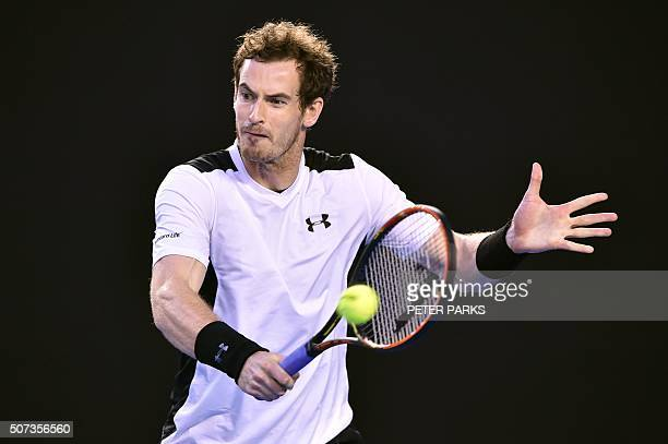 Britain's Andy Murray hits a return during his men's singles semifinal match against Canada's Milos Raonic on day twelve of the 2016 Australian Open...