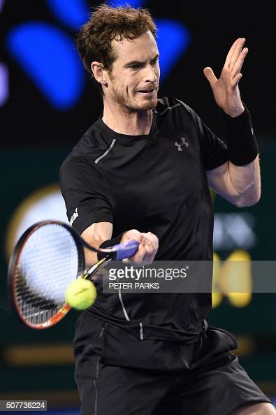 Britain's Andy Murray hits a return during the men's singles final against Serbia's Novak Djokovic on day 14 of the 2016 Australian Open tennis...