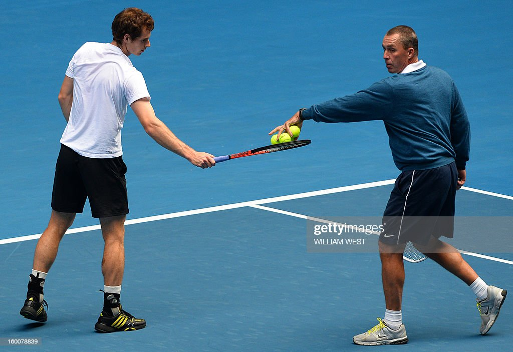 Britain's Andy Murray (L) is assisted by his coach Ivan Lendl as he takes part in a training session on day thirteen of the Australian Open tennis tournament in Melbourne on January 26, 2013, ahead of his men's singles final against Serbia's Novak Djokovic.