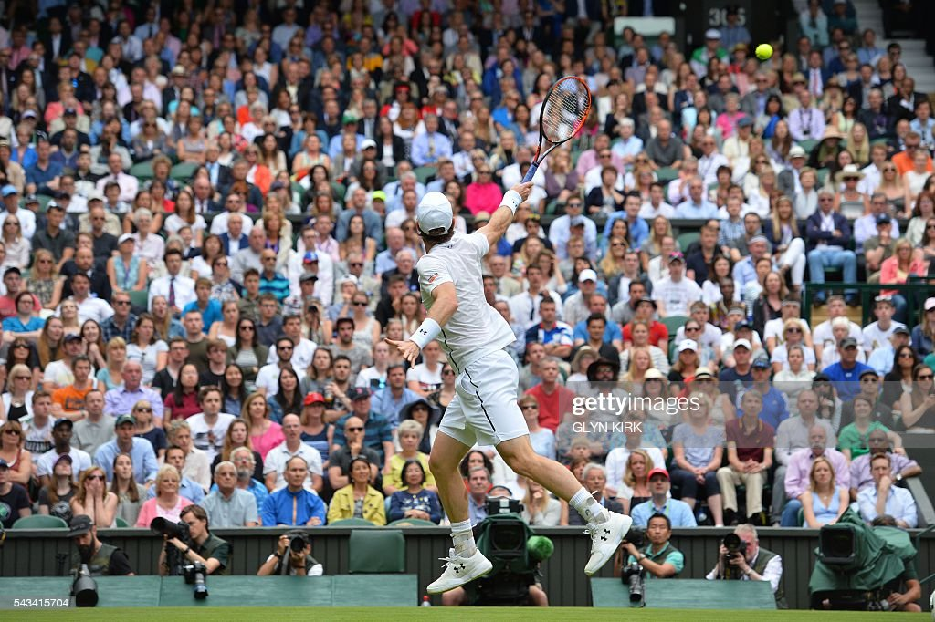 Britain's Andy Murray jumps mid-court to return against Britain's Liam Broady during their men's singles first round match on the second day of the 2016 Wimbledon Championships at The All England Lawn Tennis Club in Wimbledon, southwest London, on June 28, 2016. / AFP / GLYN