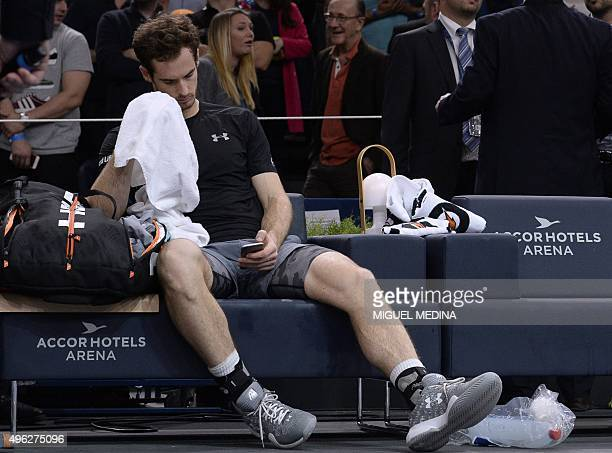 Britain's Andy Murray looks at his mobile phone after losing the final tennis match against Serbia's Novak Djokovic at the ATP World Tour Masters...