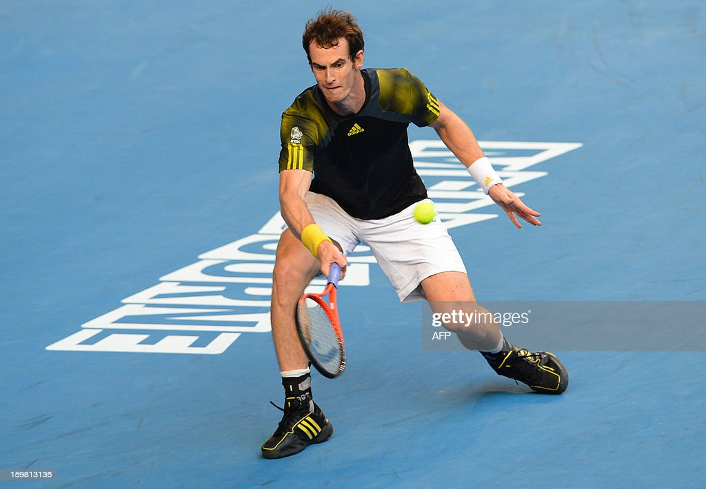 Britain's Andy Murray plays a return duing his men's singles match against France's Gilles Simon on the eighth day of the Australian Open tennis tournament in Melbourne on January 21, 2013.