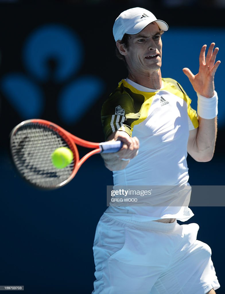 Britain's Andy Murray plays a return during his men's singles match against Ricardas Berankis of Lithuania on the sixth day of the Australian Open tennis tournament in Melbourne on January 19, 2013.