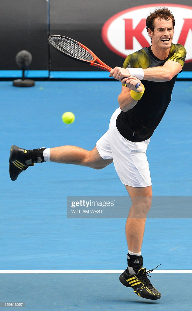 Britain's Andy Murray plays a return during his men's singles match against France's Gilles Simon on the eighth day of the Australian Open tennis tournament in Melbourne on January 21, 2013.