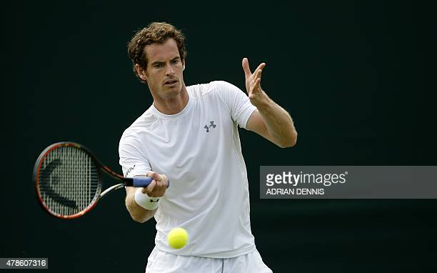 Britain's Andy Murray plays a shot during a practice session ahead of the Wimbledon Tennis Championships at the All England Tennis Club in southwest...