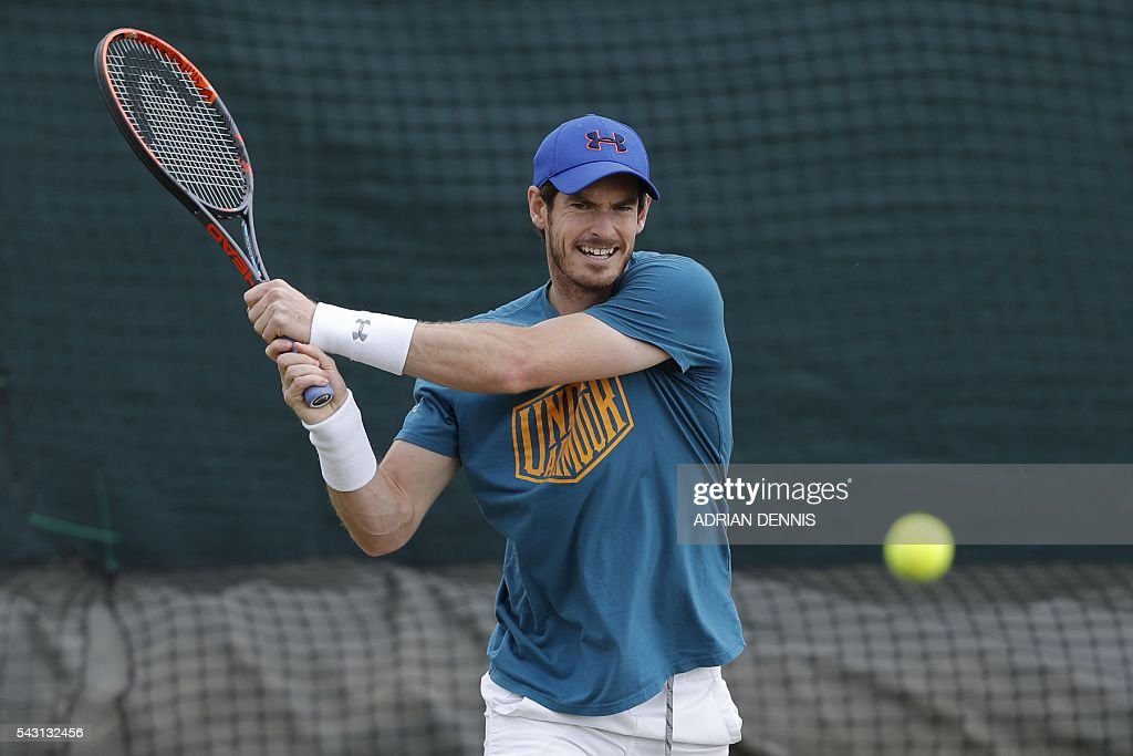 Britain's Andy Murray plays a shot on a practice court at The All England Tennis Club in Wimbledon, southwest London, on June 26, 2016, on the eve of the start of the 2016 Wimbledon Championships tennis tournament. / AFP / ADRIAN