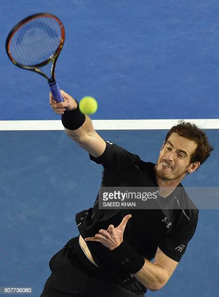 Britain's Andy Murray plays a smash during his men's singles final match against Serbia's Novak Djokovic on day fourteen of the 2016 Australian Open...