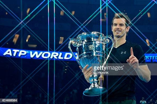 TOPSHOT Britain's Andy Murray poses holding the ATP World Number One trophy after winning the men's singles final against Serbia's Novak Djokovic on...